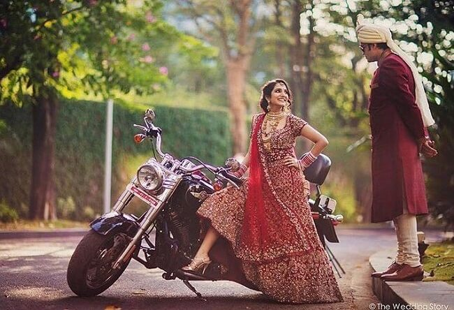 Love this shot especially the pose. the voguish Indian slay bride look and an obdient groom look. taken by-