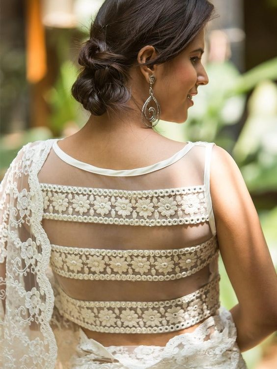 Finding a blouse for a big-fat Indian wedding, here you go with a semi- sheer back embroidered with little white flowers making it look so charming to slay a wedding