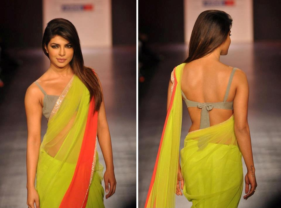 PC is killing it with an classic two color sari with lace detailing and knot tied backless blouse.