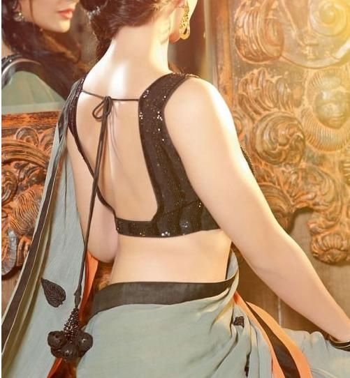 a backless blouse never fails to glimmer you up .