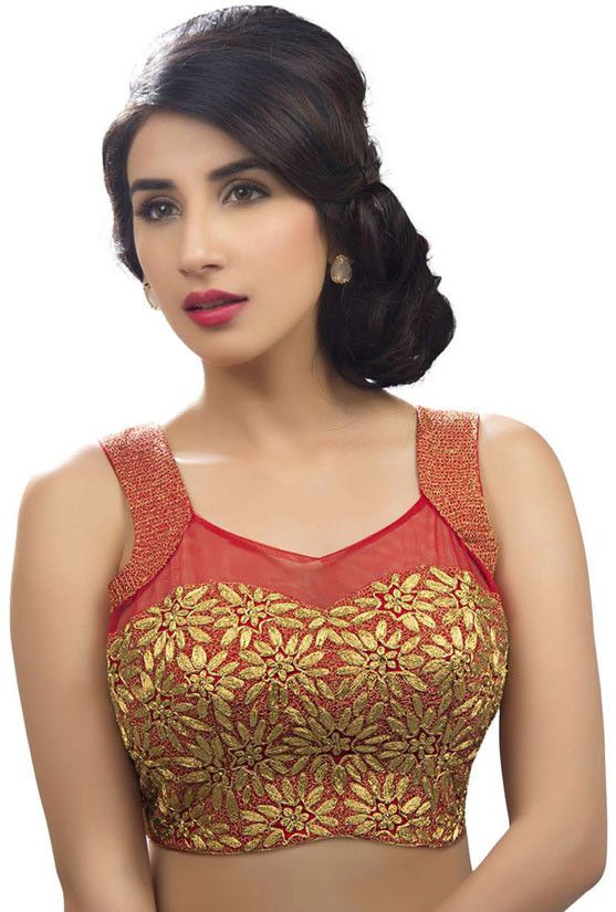 Lace and net are the two fabrics which can make your blouse look sexy. This is a red net blouse with golden embroidery and lure design to make you look a bombshell.