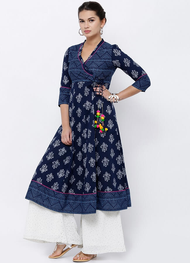 This is a very distinctive style in trend. Angrakha kurti refers to two contrast flaps which lay on each other and is tied with straps which makes it look more interesting. in this picture two different prints lay on each other and are tied with dark blue strap. To add a touch of charm pom pom are attached to the straps. angrakha kurti intermingled with anarkali kurtis or floor length kurtis are n the top trend list.