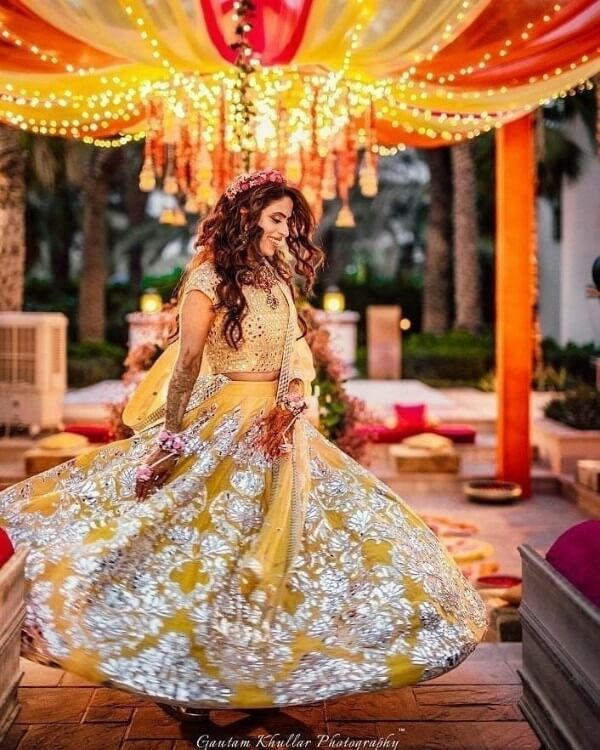 happy bride dancing in mehndi ceremony