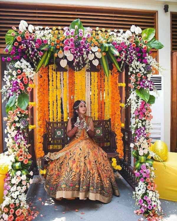 Indian Mehndi ceremony Photoshoot & flower Decoration Ideas for wedding bride