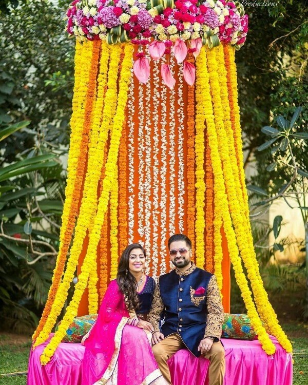 Indian Mehndi ceremony Photoshoot & marigold flower Decoration Ideas for wedding couple