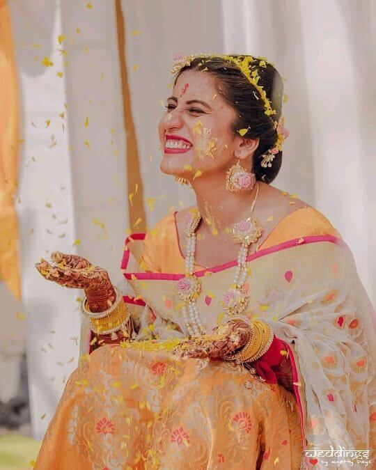 Showers of flowers: Unique Haldi Ceremony Photoshoot Ideas To Make Your Wedding Special
