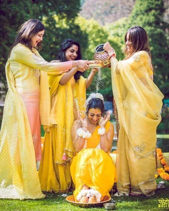 Have some fun with water: Unique Haldi Ceremony Photoshoot Ideas To Make Your Wedding Special